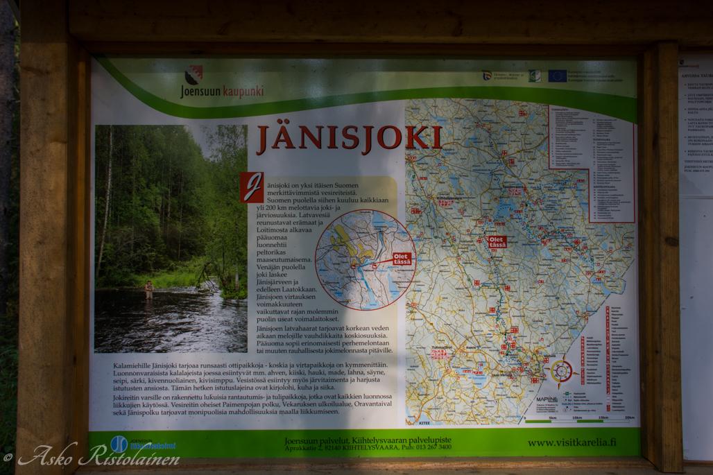 Jänisjoen infotaulu Peltokoskella.